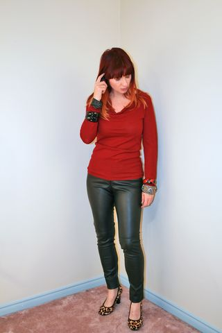Black leather pants and red sweater