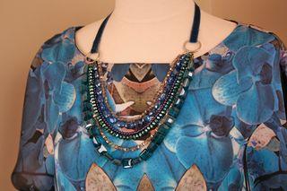 Jewel necklace on blue dress suzanne carillo