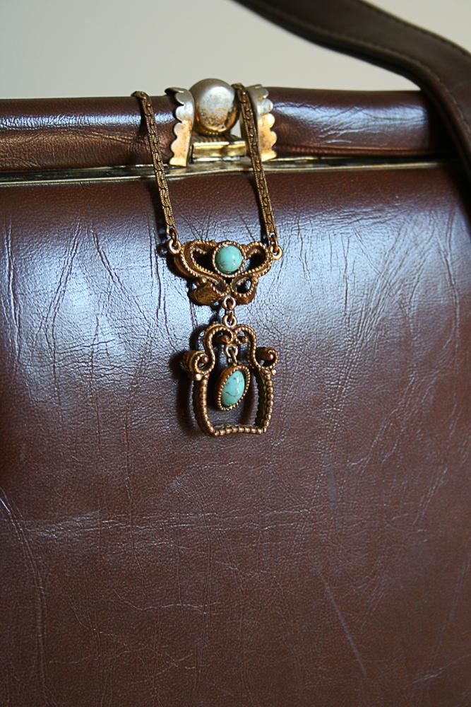 Vintage necklace and handbag close