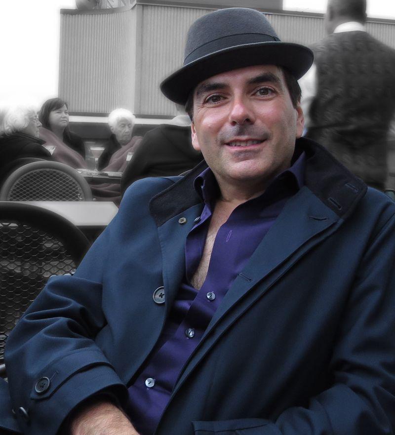 Robert purple shirt grey hat